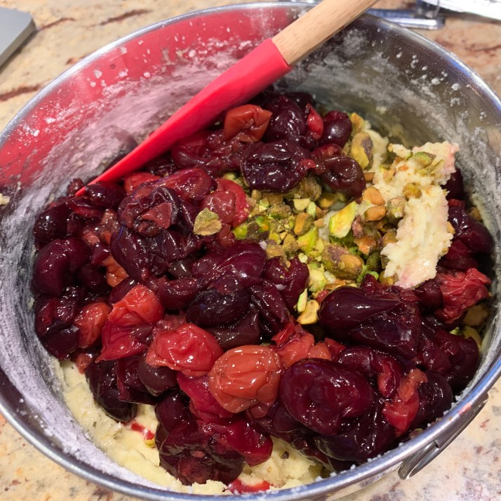 fold in the chopped pistachios and cherries into the batter