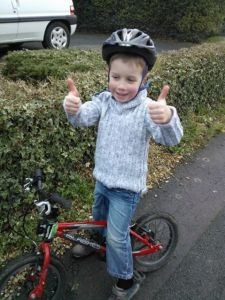 """BigSmall-very pleased with himself having biked all the way up the """"big hill on the easy from Grandma's"""" without stopping (or being pushed!)"""