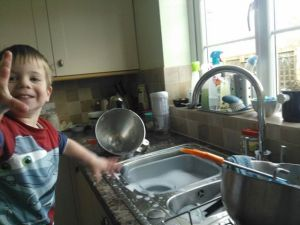 """Does anyone else remember when """"helping"""" with the washing up was this much fun (and necessitated a change of clothes…)?!"""