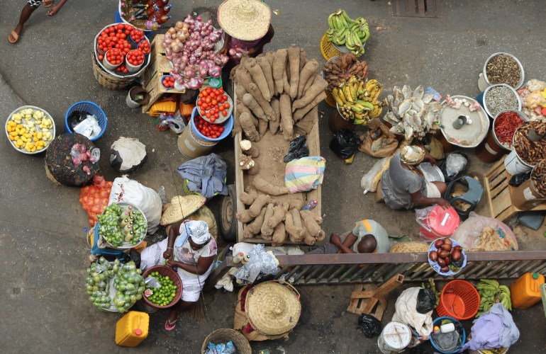 An aerial view of ladies selling vegetables at Makola Market Accra taken from the parking garage