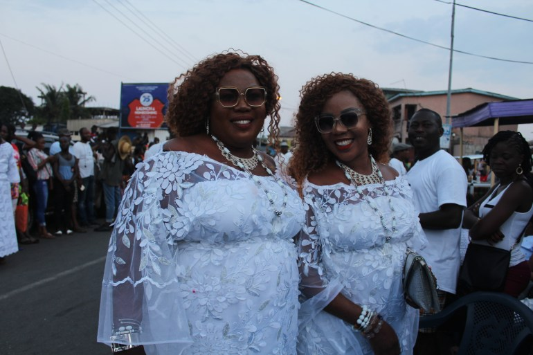 Twin ladies wearing white lace dresses at the Jamestown Accra Ga Mashie Twin Festival