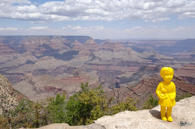 Yellow Clonette doll Zadie from Ada, Zadie and Co project stands at the Grand Canyon in Arizona