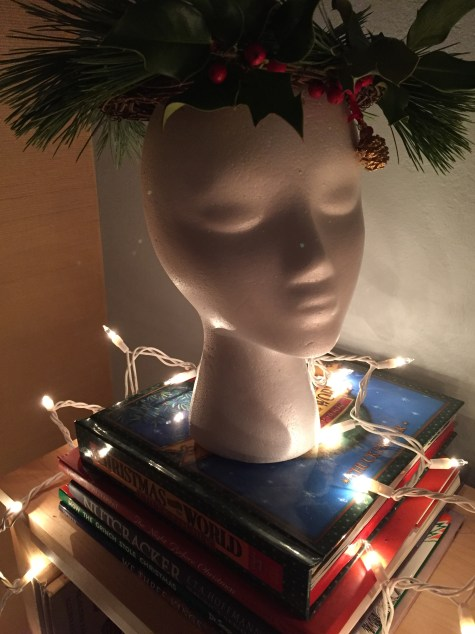 Hildegard's Head on a Stack of Christmas Books