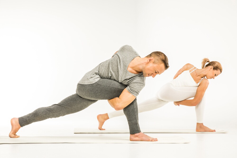 yogis in bound side angle pose