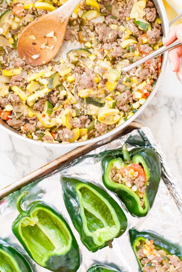 Southwest Stuffed Poblano Peppers with Melty Cheddar Cheese - this healthy dinner recipe is filled with beef, summer vegetables, and is under 500 calories!