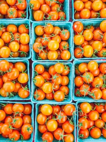 orange cherry tomatoes in baskets