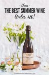 bottle of Bugey-Cerdon La Cueille French sparkling wine with empty wine glasses and flowers