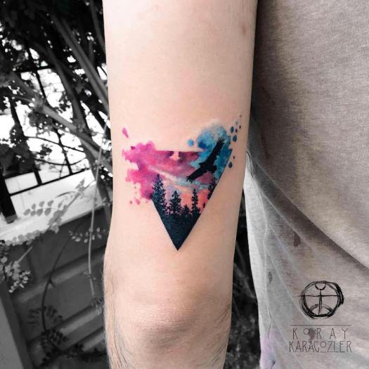 triangle landscape watercolor tattoo by Koray Karagözler