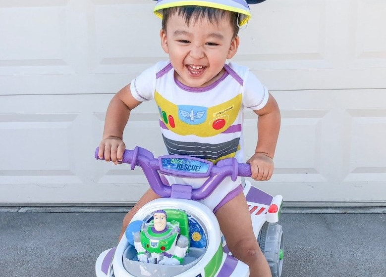 happy kid on a toddler bike