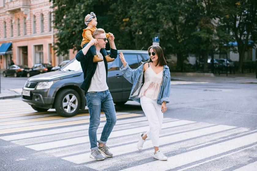 happy family crossing the street