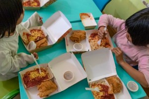 Children eating Jollibee chicken joy and spaghetti