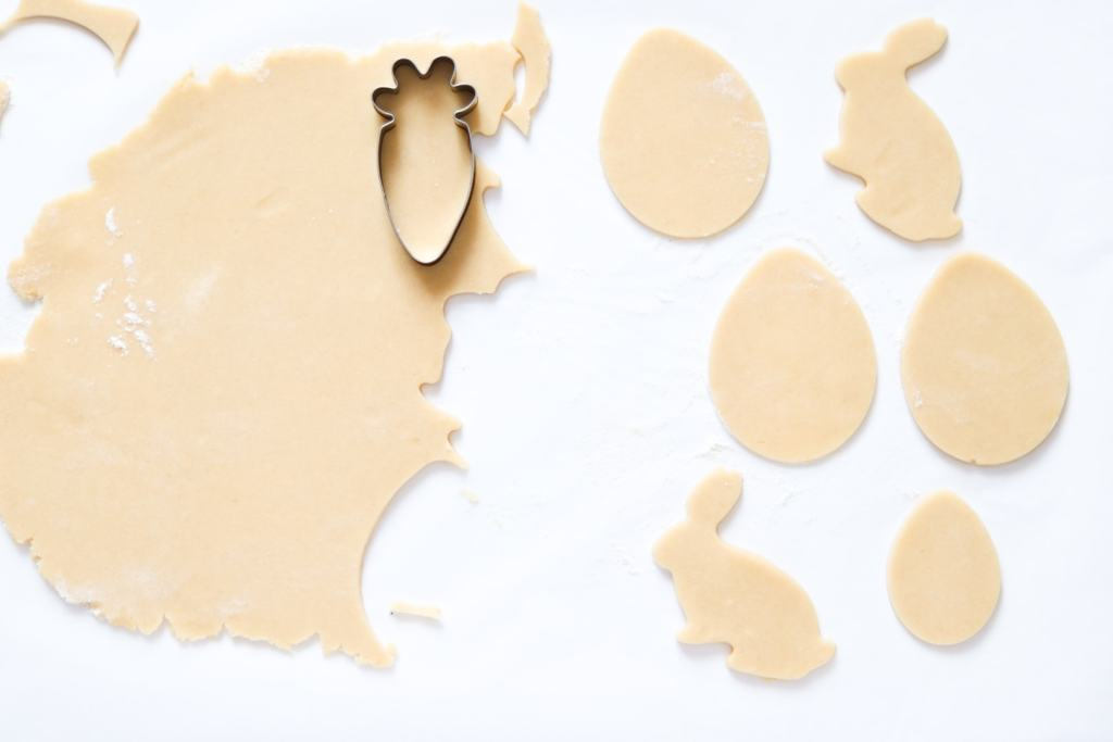 With your Easter cookie cutters, cut shapes out of your sugar cookies dough
