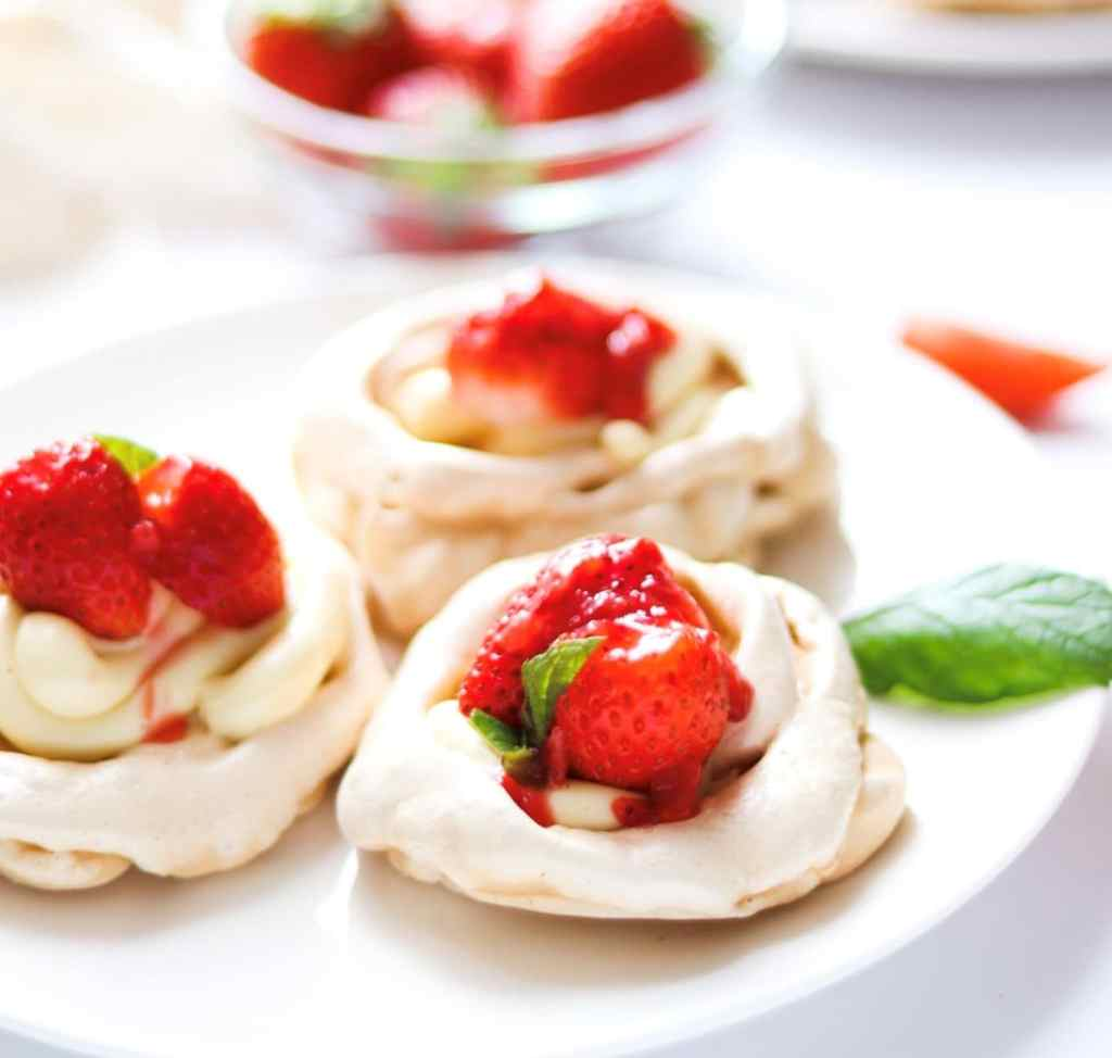 meringue nests with white chocolate ganache and strawberry filling.