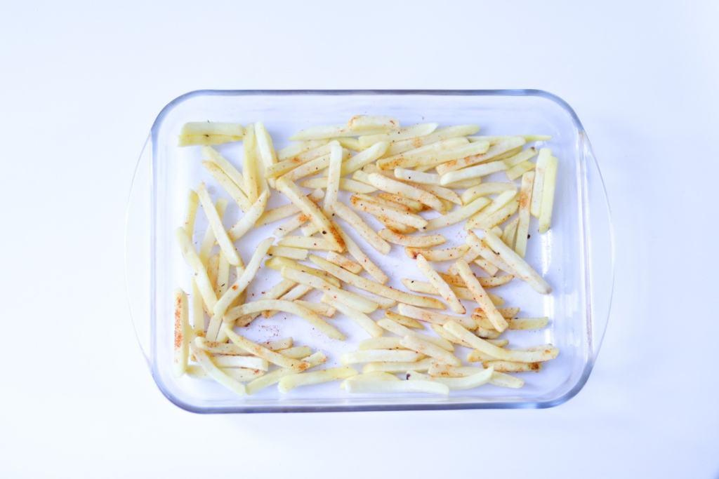 Chips sprinkled with salt and Cajun seasoning
