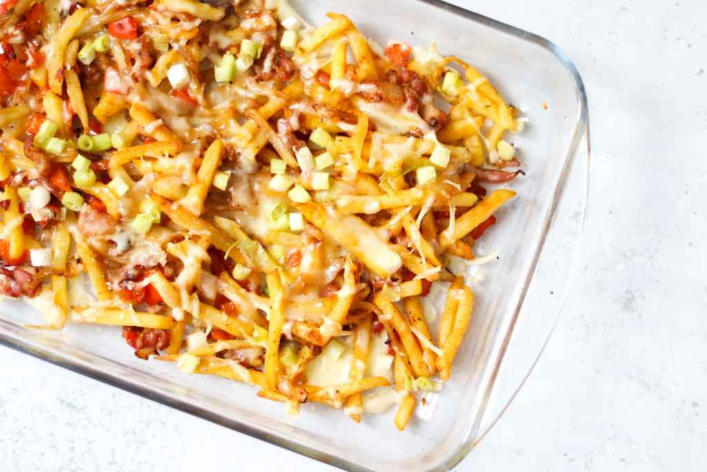 Dirty fries recipe with Cajun seasoning, bacon and melted cheese.