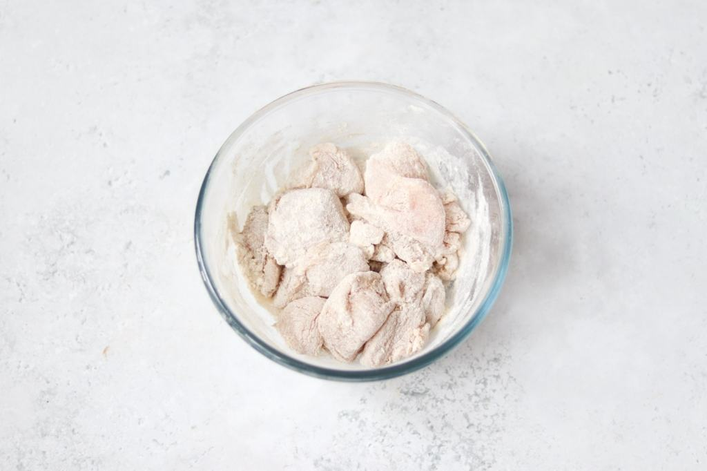 Chicken coated in salt, white pepper and flour.