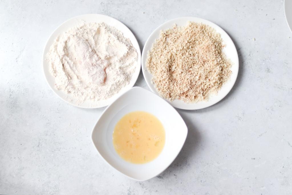 Dunking chicken into flour