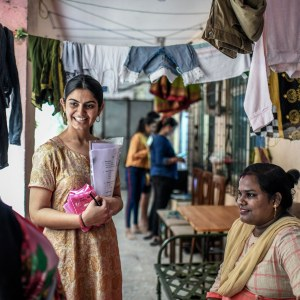 Suhani talks to the women from the neighbourhood buildings to her office in Mumbai about the pads and demonstrates its usage