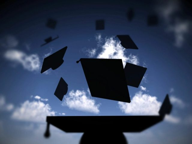 Image of University Graduation hats flying into the air