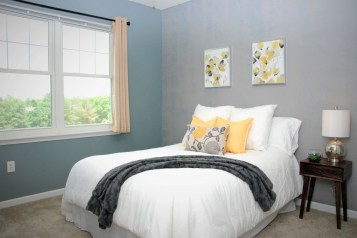 Picture of vacant Bedroom Staging with yellows and grays