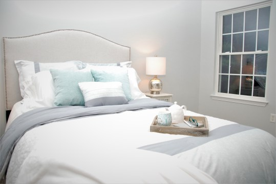 Picture of vacant master bedroom staging in light colors