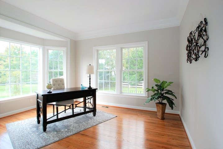 Picture of a large home office staged with brown desk