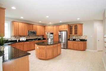 Picture of large kitchen home staging with oak cabinets