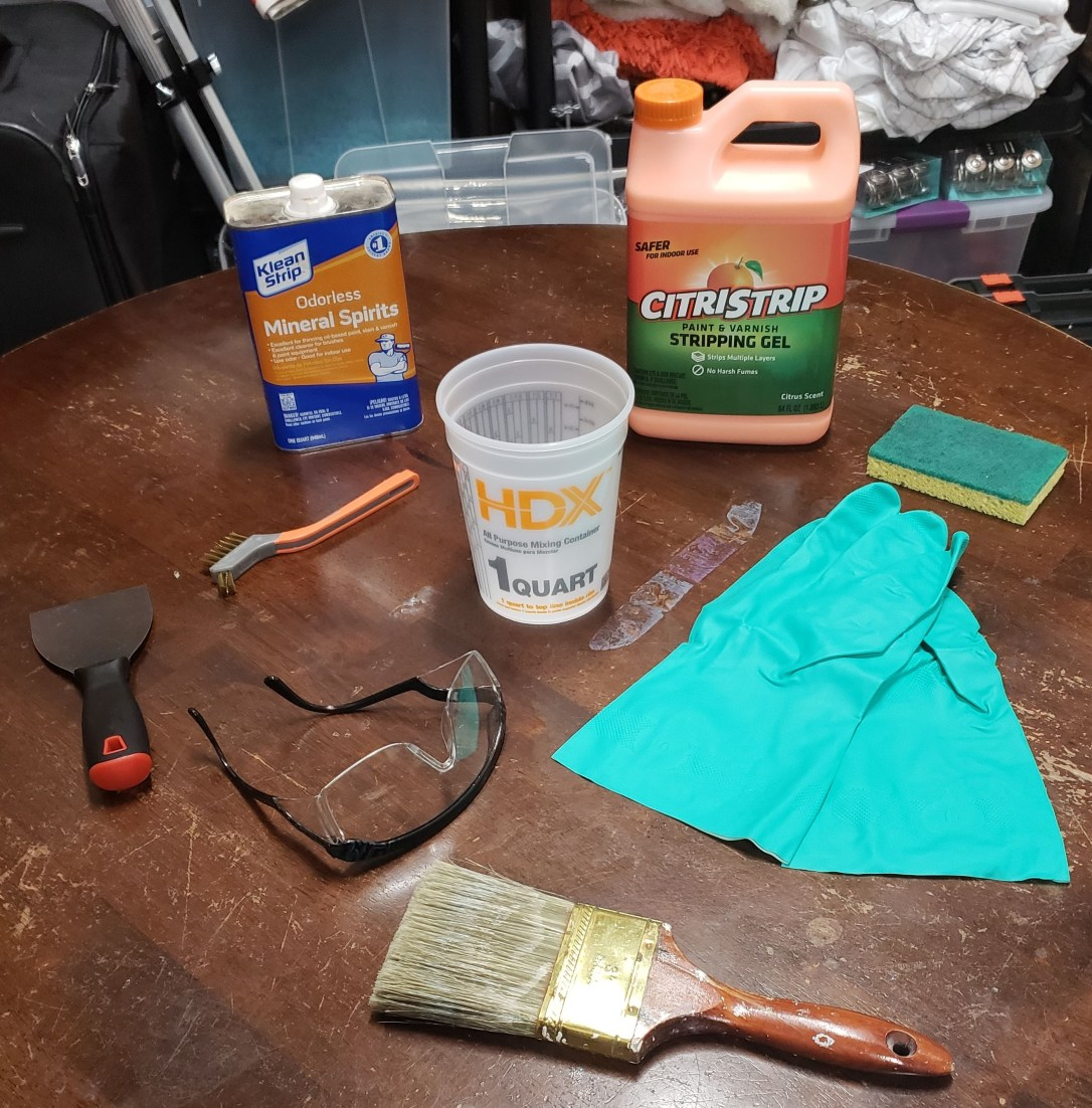 Picture of supplies needed to remove the finish from a table