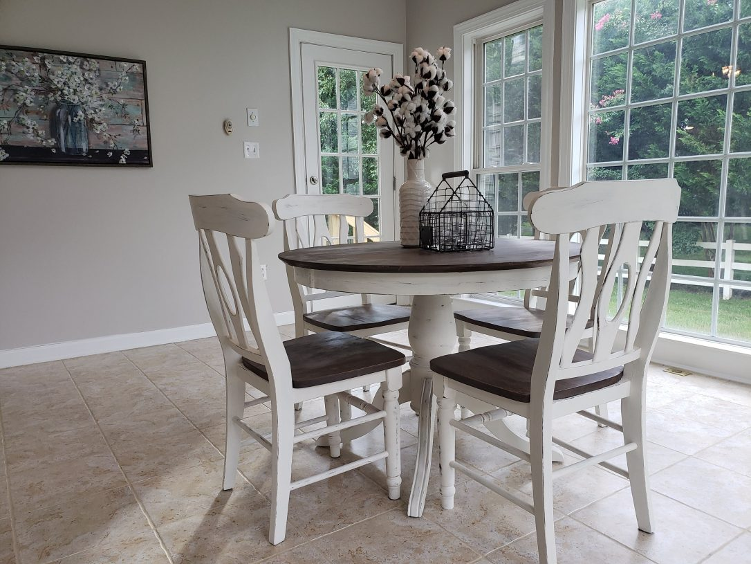 Farmhouse style round pedestal table with white chalk paint finish