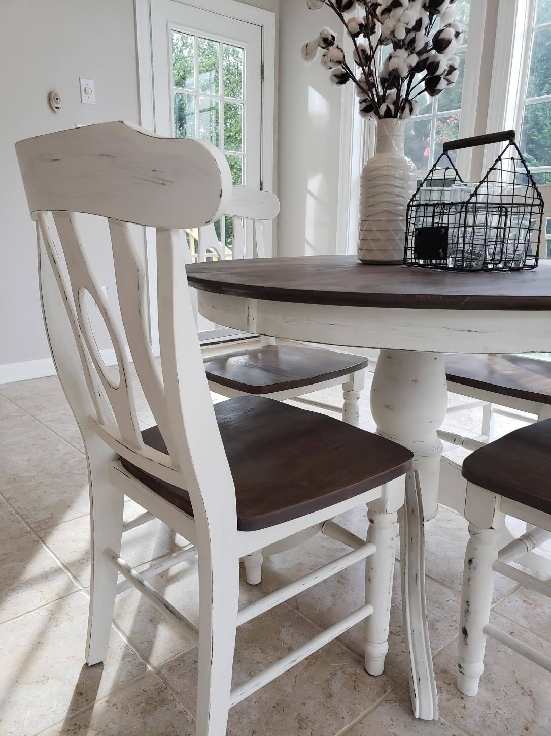 Farmhouse style table and chairs with distressed chalk paint finish