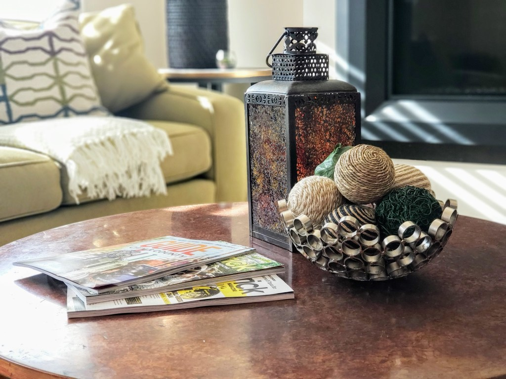 coffee table vignette with yarn balls and lantern