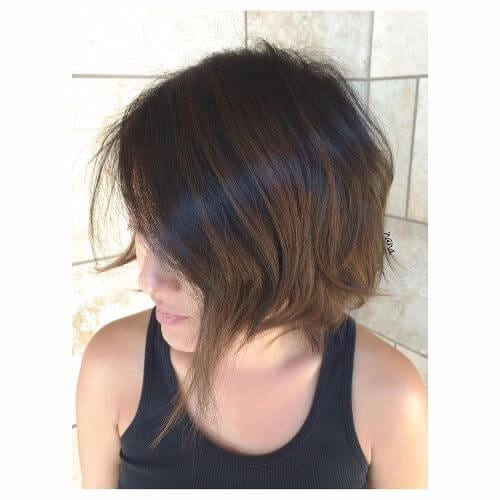 asymmetrical bob on brown hair
