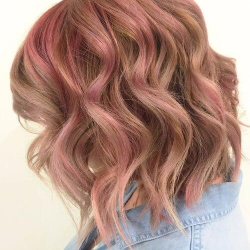 lob haircut with pink highlights