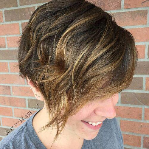 outgrown pixie cut with blonde highlights