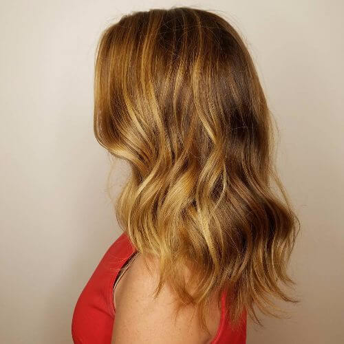caramel balayage highlights on dark blonde hair
