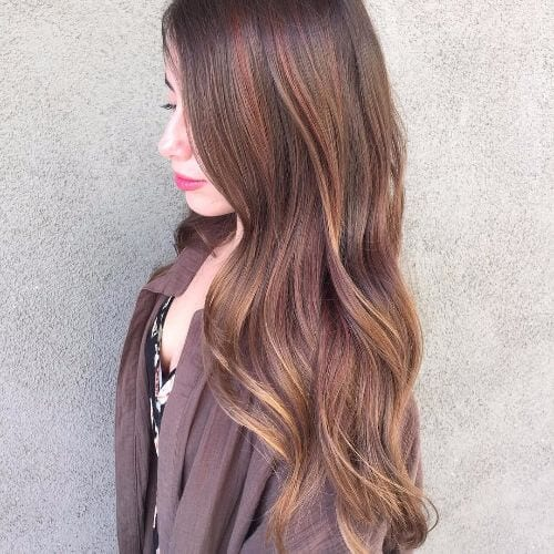 long wavy hair with caramel highlights