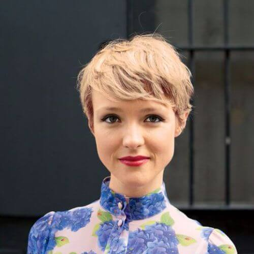 blonde woman blue shirt pixie cut