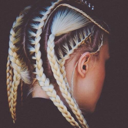young woman blonde and black hair goddess braids