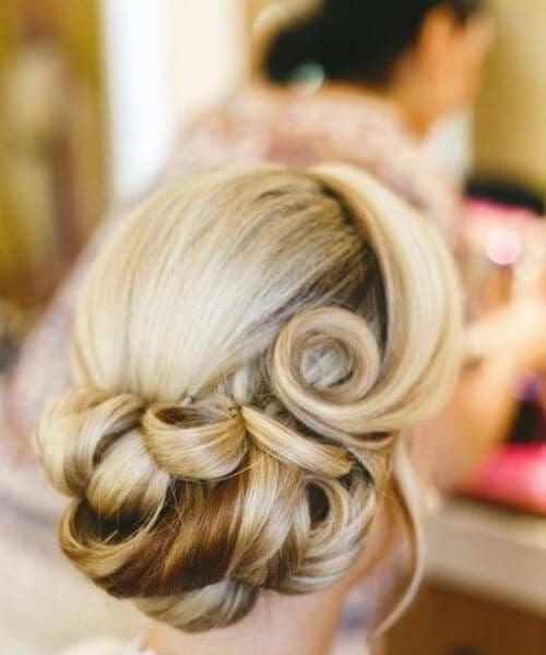 vintage curls in buns homecoming hairstyles