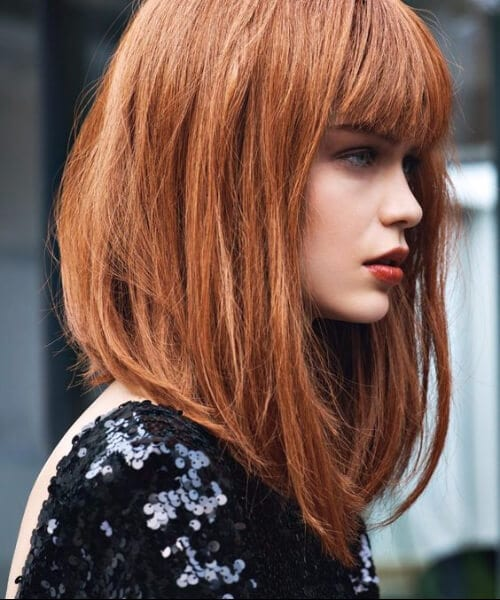 red asymmetrical lob shoulder length bob