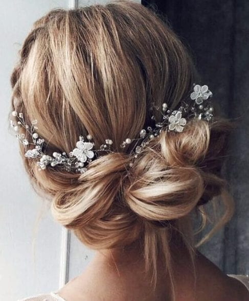 messy bun flowers wedding hairstyles for long hair