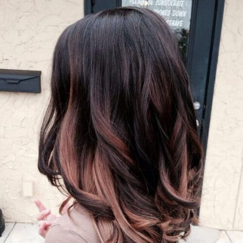 brunette with rose gold peekabo highlights