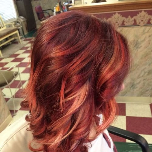 Red Hair Color with Blonde, copper and rose gold high highlights and lowlights