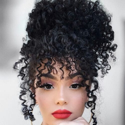 beehive curly hair with bangs