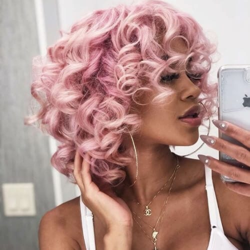 pink curly hair with bangs