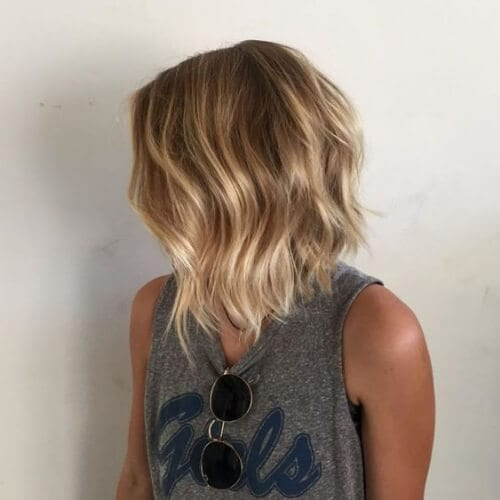 Glossy Blonde Bob with Jagged Ends a line bob haircut