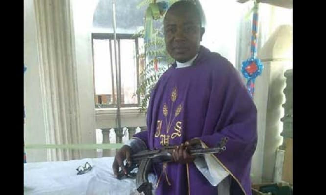Catholic Priest Protect Himself With AK47