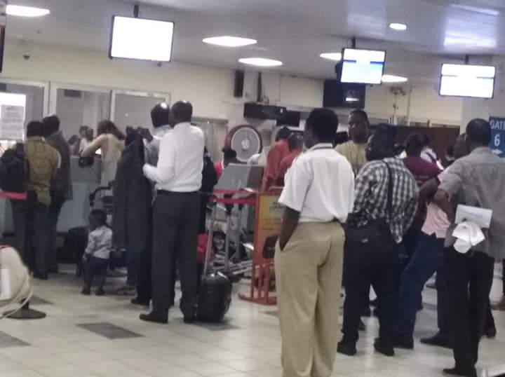 Angry Africa World Airline passengers picket at Kotoka