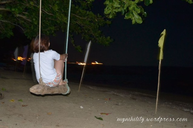 Me, enjoying the night breeze and view while swinging