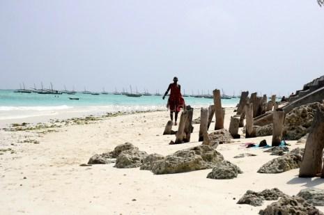 Masai walking on the beach
